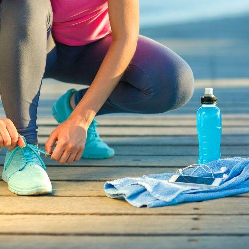 Running Woman Tying Shoe Laces